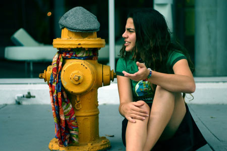 crazy-woman-talking-to-fire-hydrant